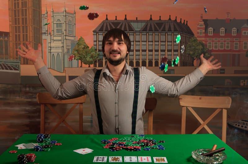 Poker player enjoys winning. royalty free stock photos