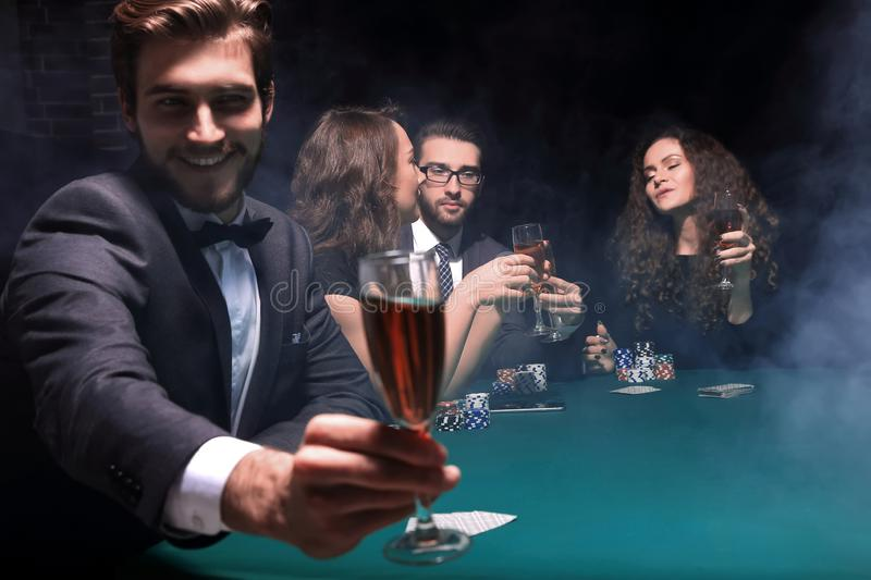 Poker player with a glass of wine stock image