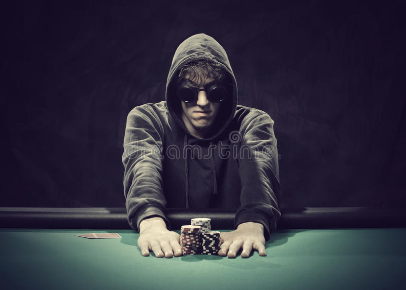 Poker player going all-in. Professional poker player betting everything on one hand royalty free stock photography