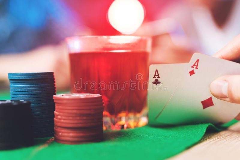 A poker player looks at his cards. stock photos