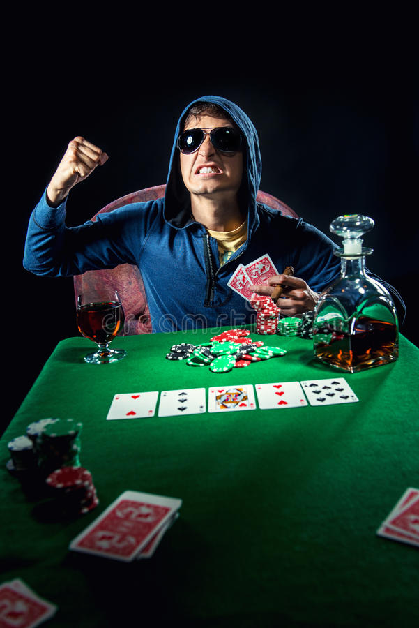 Poker player. Photo of young poker player stock photo