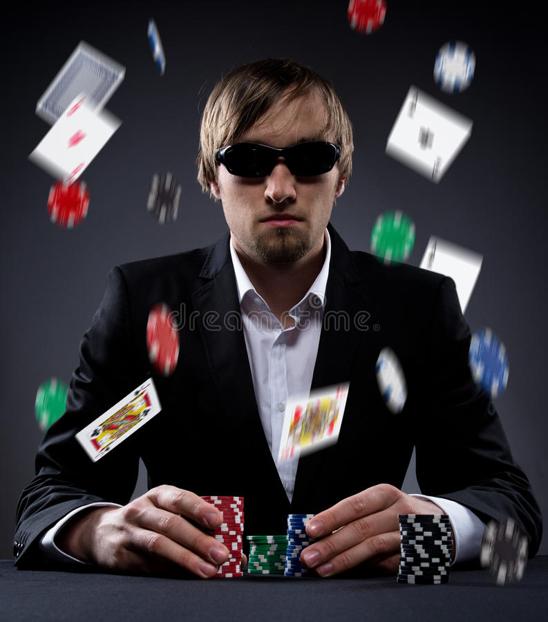 Poker player. Portrait of a professional poker player stock image