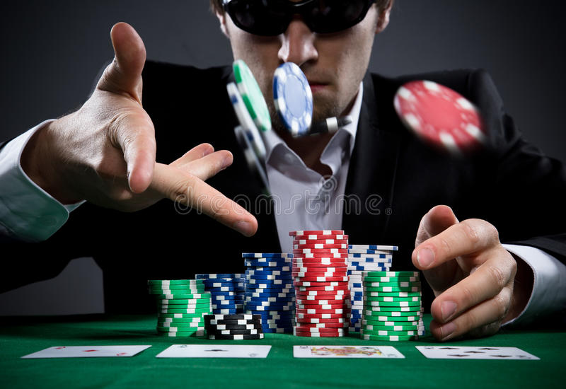 Poker player. Portrait of a professional poker player royalty free stock photo