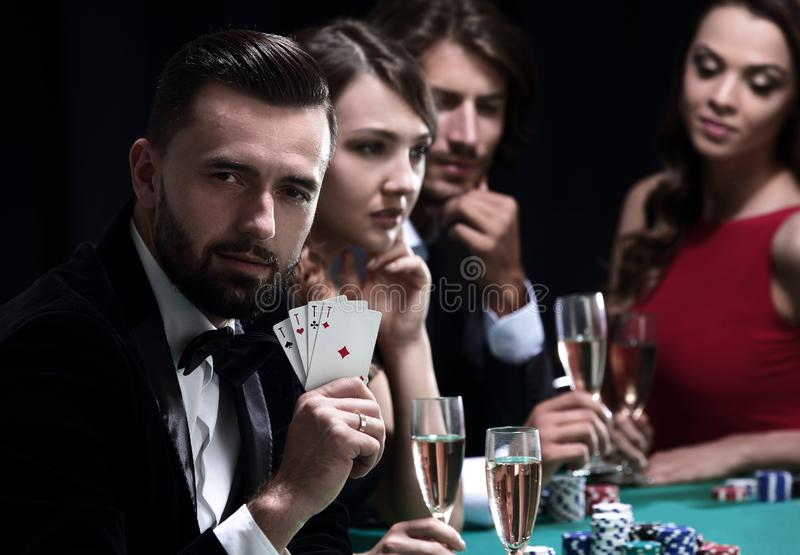 Poker player to four aces over dark background royalty free stock photos