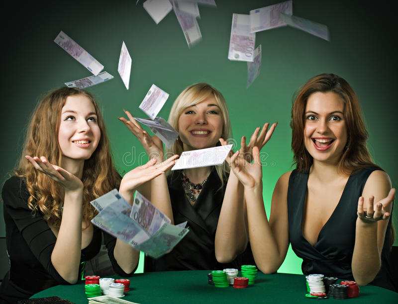 Poker players in casino with cards and chips royalty free stock image