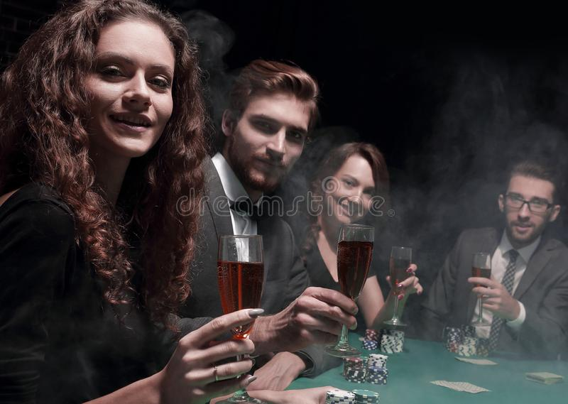 Poker players sitting around a table at a casino. Concept of fortune stock image