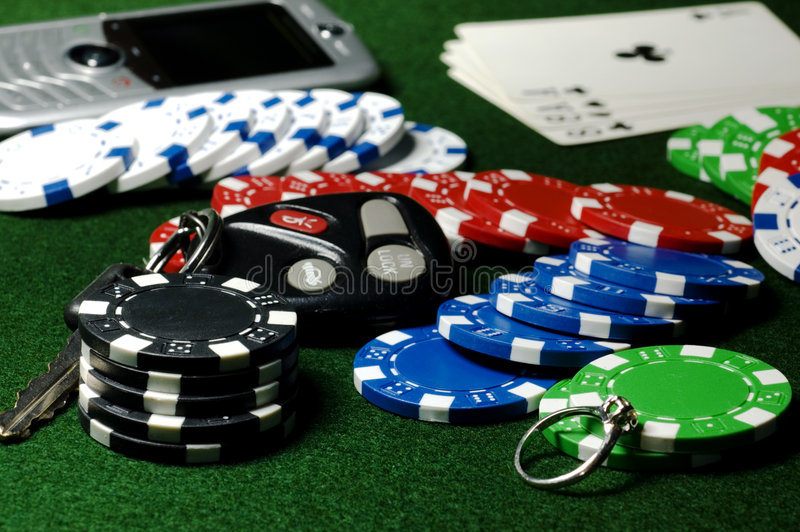 Poker Pot. Of chips, car keys, diamond ring, and cell phone stock images