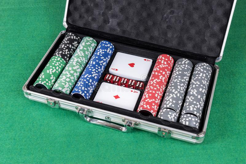 Poker set with cards, dice and chips stock images