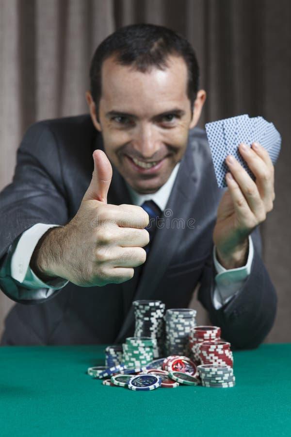 Poker-Sieger, Geschäftsmann, gewonnen im Pokerspiel lizenzfreie stockfotografie