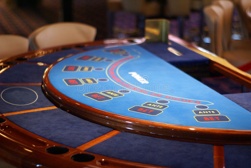 Poker table blu. E without chips and without card stock images