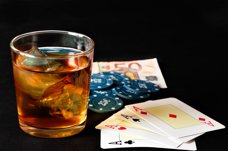 Poker, whiskey and money. Poker of aces with poker chips and whiskey. Horizontal image stock images