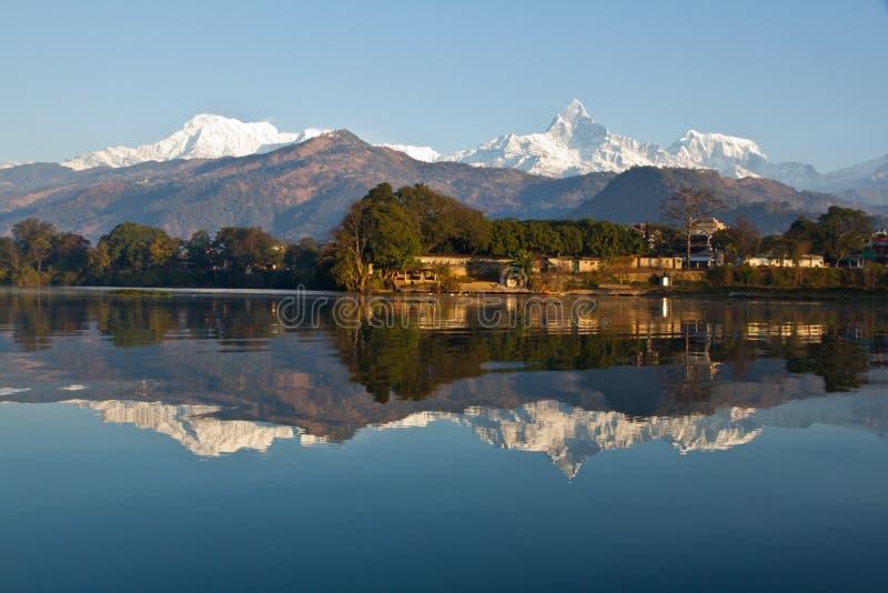 Pokhara Lakeside. With the reflection of Machhapuchhare and the Annapurna Range in Fewa Lake stock image