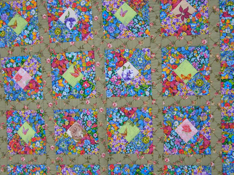 Pokhara. Nepal. April 14-2015. Background. Patchwork a blanket in flowers and butterflies. Handnade stock photography