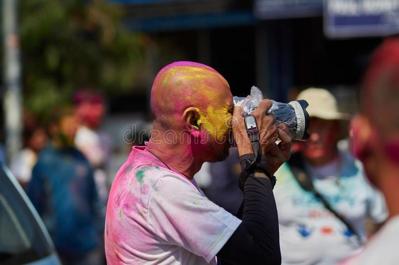 Pokhara, Nepal - APRIL 11, 2019: People during Festival of colours Holi Pokhara. Holi is traditional holiday of India stock images