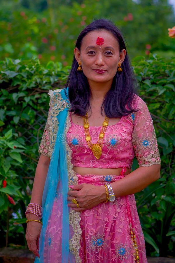 POKHARA, NEPAL - NOVEMBER 04, 2017: Close up of beautiful woman wearing a typical clothes Pokhara, Nepal, in nature. Background stock image