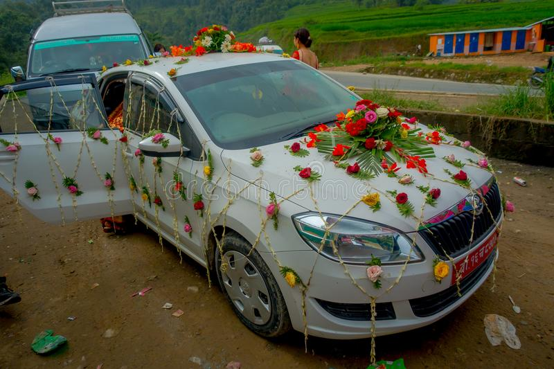 POKHARA, NEPAL OCTOBER 10, 2017: Beautiful car adorned with flowers and villagers celebrating a nepalese wedding in. Besisahar, Nepa stock image
