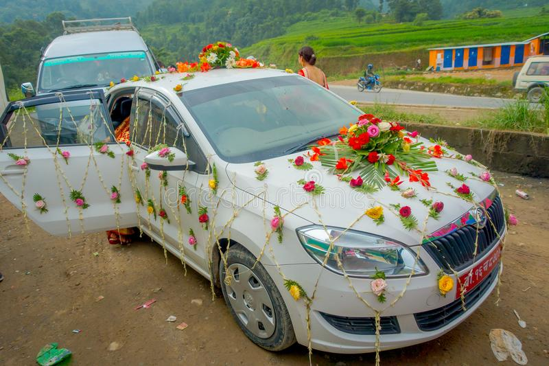 POKHARA, NEPAL OCTOBER 10, 2017: Beautiful car adorned with flowers and villagers celebrating a nepalese wedding in. Besisahar, Nepa royalty free stock photos