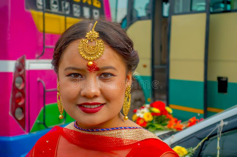 POKHARA, NEPAL OCTOBER 10, 2017: Portrait of a beautiful woman wearing typical clothes and jewelry of weeding royalty free stock photography