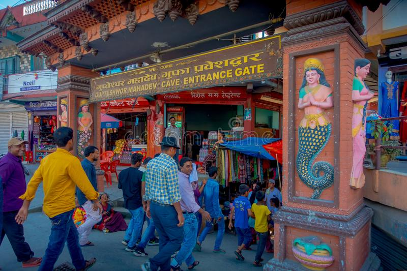 POKHARA, NEPAL OCTOBER 10, 2017: Unidentified people at the enter of Tapkeshwar Mahadev Temple in Dehradun is one of the stock photos