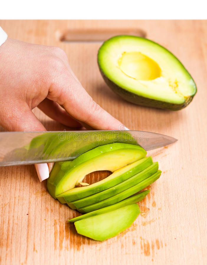 Pokrajać świeżego avocado zakończenie zdjęcie stock