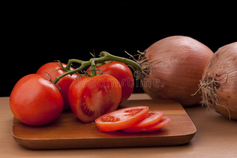 pokrojeni pomidory całe obraz stock