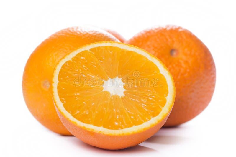 Pokrojone i całe pomarańcze obraz royalty free