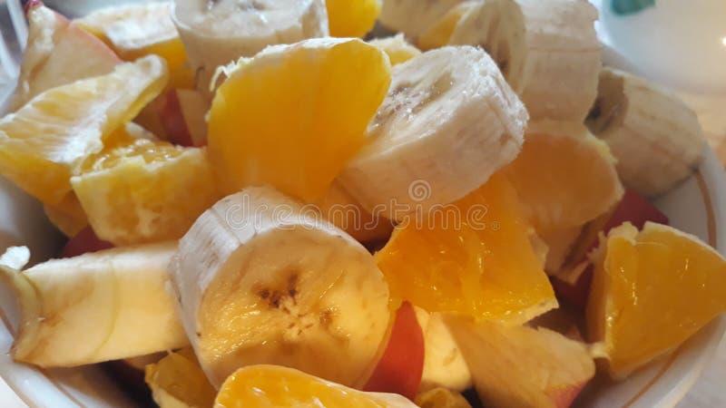 Pokrojonego †‹â€ ‹soczysty banan i pomarańcze zdjęcie stock