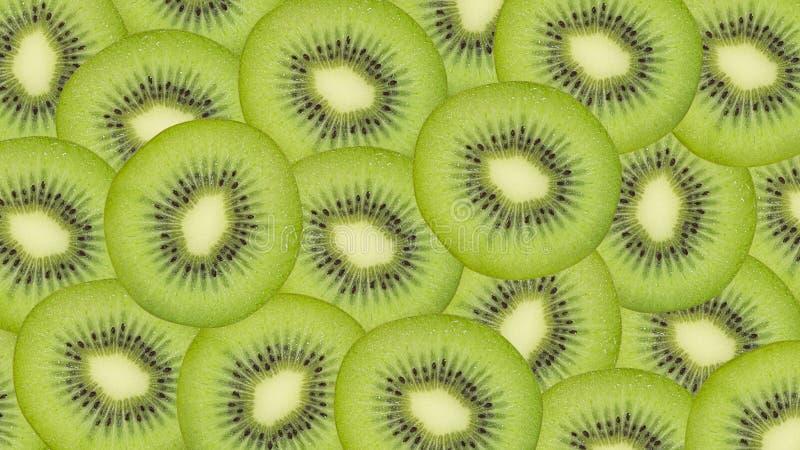 Pokrojony kiwi owoc wzoru tło fotografia stock