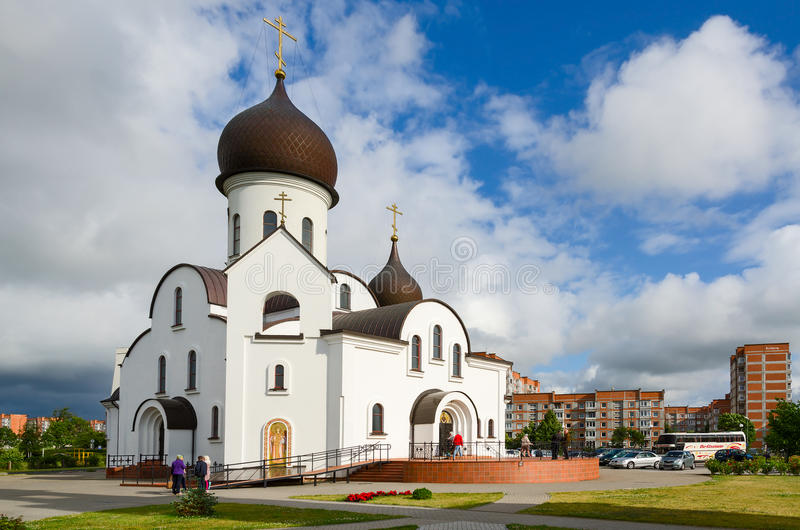 The Pokrovo- Nicholas Church, Klaipeda, Lithuania. KLAIPEDA, LITHUANIA - JULY 11, 2015: Unidentified people are near the church in honor of the Protection of the royalty free stock photo