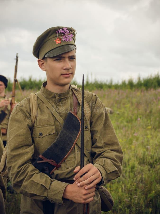 POKROVSKOE, SVERDLOVSK OBLAST, RUSSIA - JULY 17, 2016: Historical reenactment of Russian Civil war in the Urals in 1919. Soldier stock images