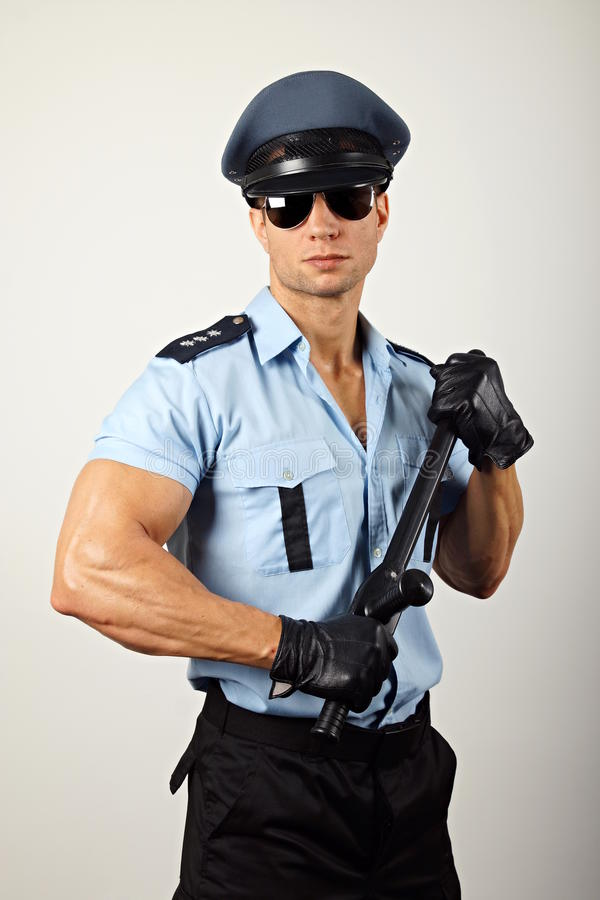 Polícia com cassetete imagens de stock