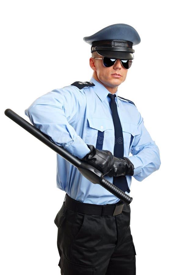 Polícia com cassetete hoding imagens de stock royalty free
