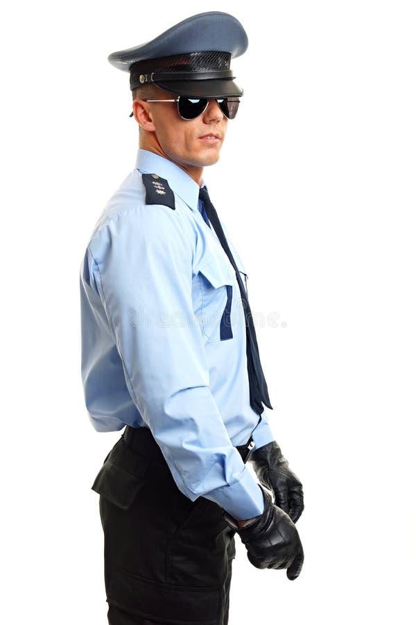 Polícia com cassetete hoding foto de stock