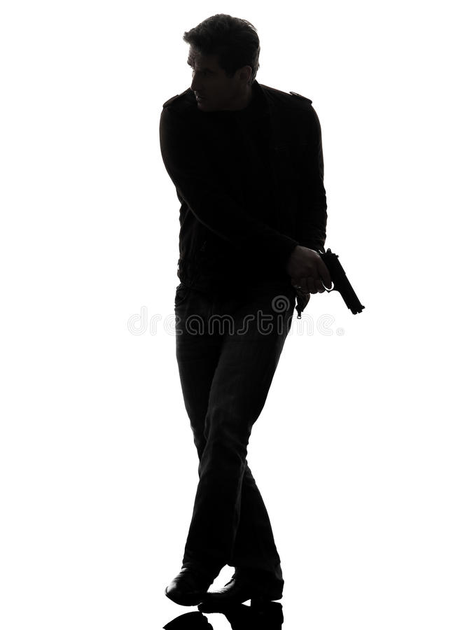 Polícia do assassino do homem que guardara a silhueta de passeio da arma imagens de stock