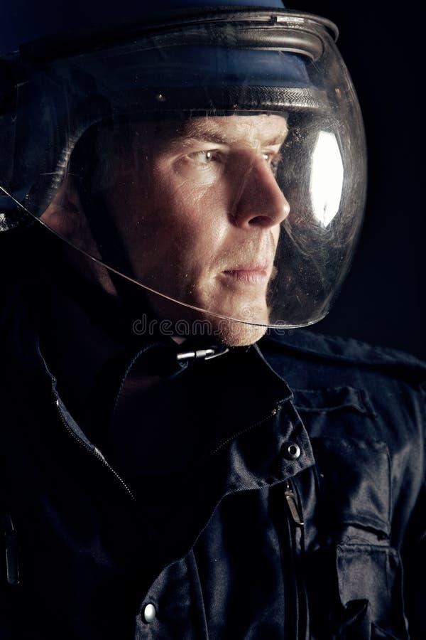 Polícia do motim com um capacete imagem de stock royalty free