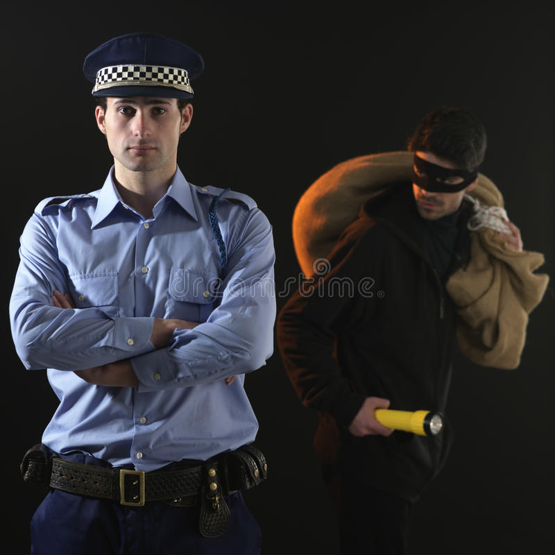 Polícia e ladrão. Cena da extorsão. imagens de stock royalty free