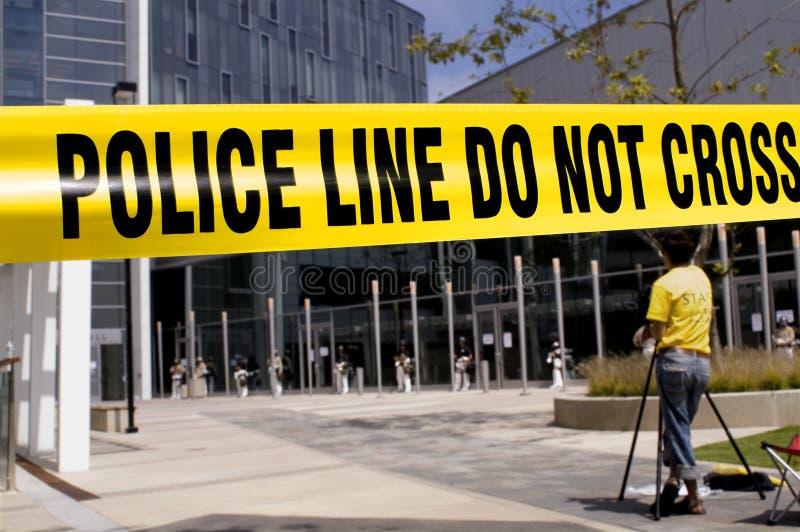 Polícia-linha-operador cinematográfico foto de stock