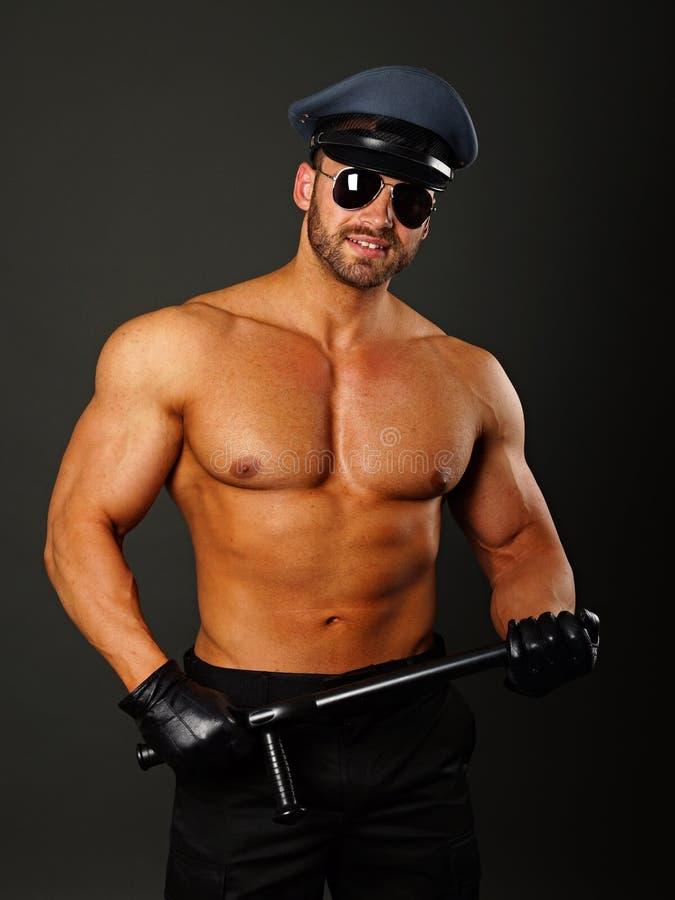 Polícia muscular com cassetete imagens de stock