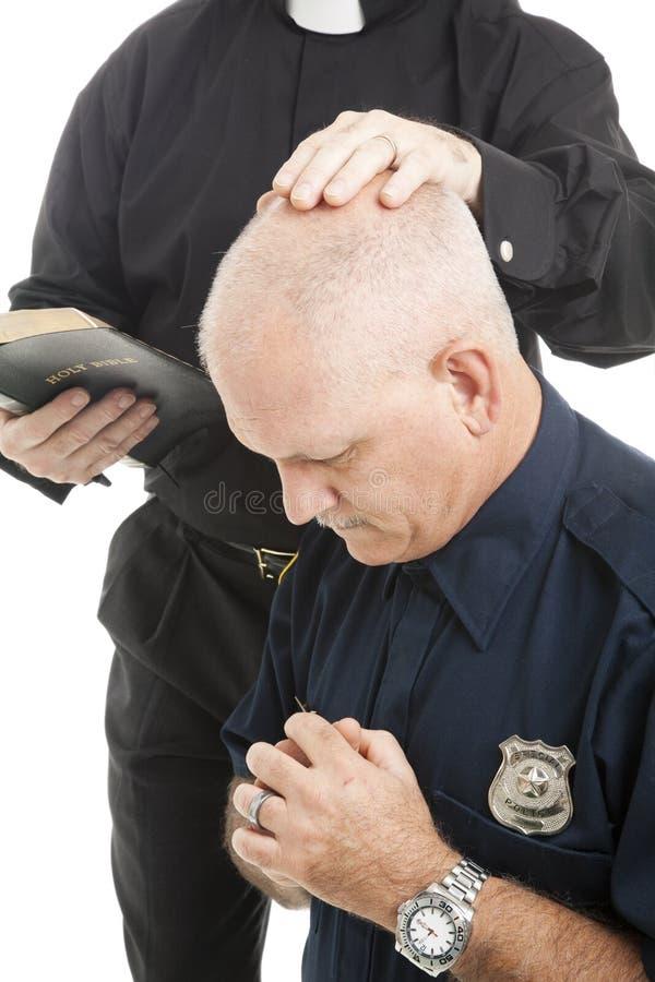 Polícia na oração imagens de stock
