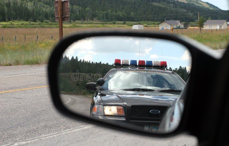 Polícia no espelho imagem de stock