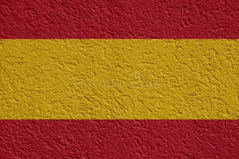 Política de España o concepto del negocio: Pared española de la bandera con el yeso, textura foto de archivo libre de regalías