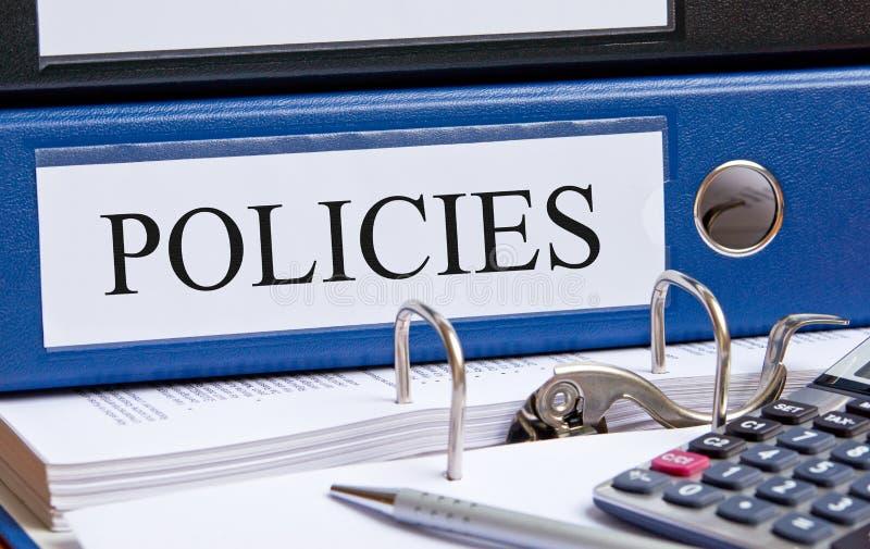Políticas - pasta azul com texto no escritório imagem de stock royalty free