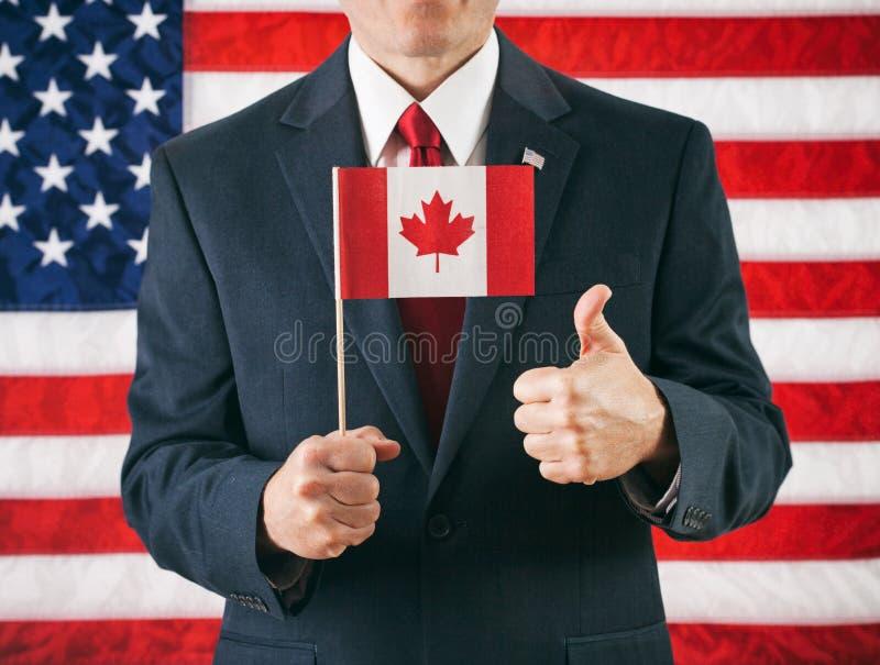 Político: Dando à bandeira canadense os polegares acima fotografia de stock royalty free