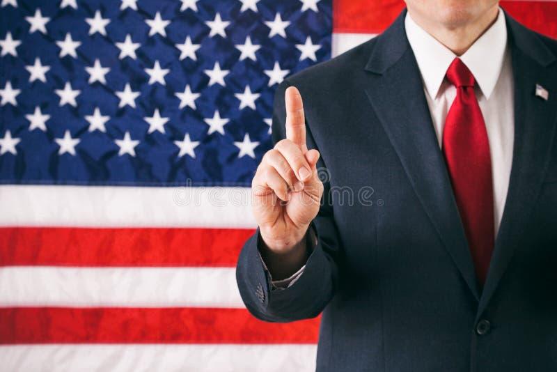 Político: Hombre con el finger en gran número una posición imagen de archivo libre de regalías