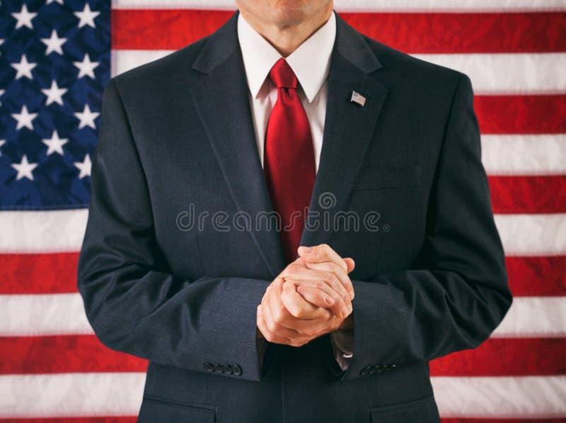 Político: Homem com as mãos abraçadas e rezar imagens de stock