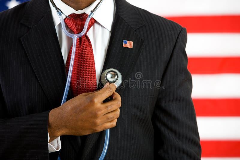 Político: Llevar a cabo un concepto médico del estetoscopio imágenes de archivo libres de regalías