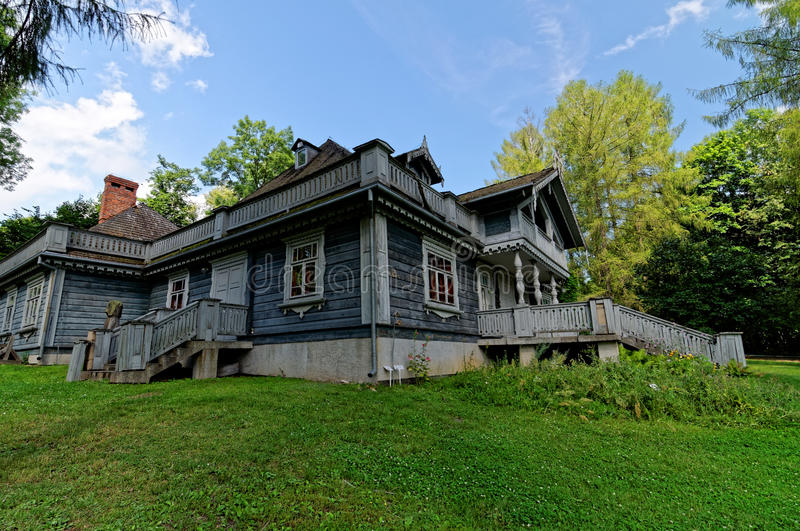 Poland, Bialowieza Palace Park. Old wooden, historic hunters manor house. Oldest building in Bialowieza. stock image