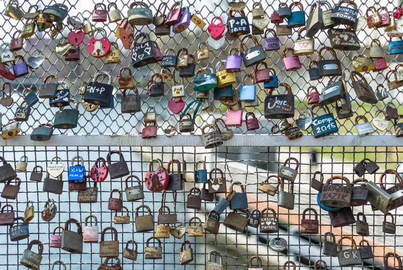 Poland, Bydgoszcz april 2018. Many hanging padlocks on the bridge. Concept love forever - Valentine. stock images