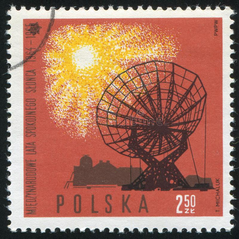 Radio telescope. POLAND - CIRCA 1965: stamp printed by Poland, shows Radio telescope dish, Torun, circa 1965 royalty free stock image