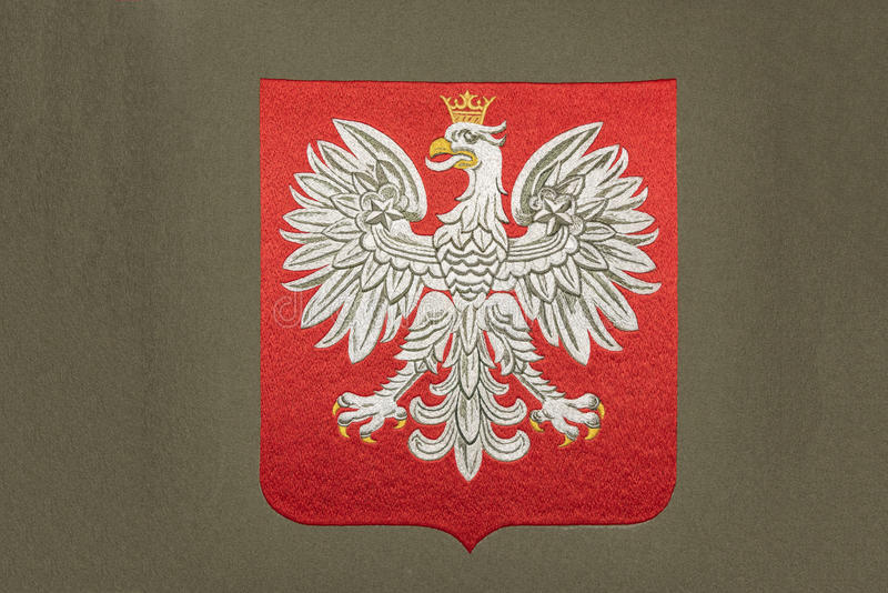 Poland coat of arms. Embroidery of Poland coat of arms on gray fabric stock illustration